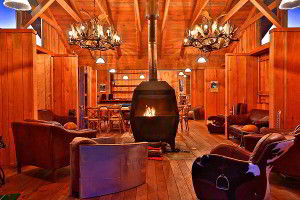 Common area with wood fire at Bruny Island Lodge