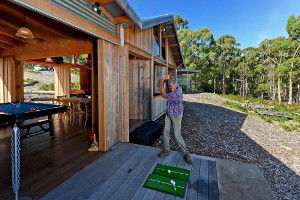 Playing some golf at the Lodge. The Lodge has a chip and putt golf area where you can try to get a hole in one.
