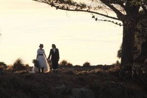Wedding photos with the sunset for these two special brides.