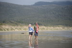Couple enjoying Cloudy Bay beach at Bruny Island in the magical South Bruny National Park