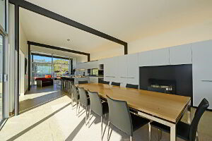 Dining area with a long dining table. Perfect for a large family dinner.