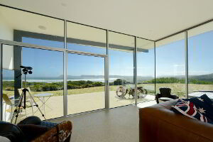 Cloudy Bay Beach House has a spectacular view of the beach from inside the house