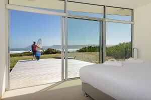 Check the surf right from bed. Or enjoy watching local surfers catching waves from the lounge room