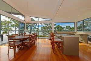 Modern kitchen and dining area with views directly over the water