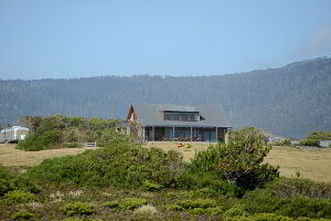 Distant view of Cloudy Bay Villa, Bruny Island taken from Whalebone Point on the private walking track