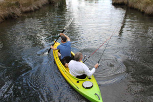 Canoeing and fishing at the same time near Saintys Creek Cottage