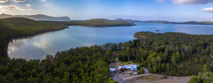 Daytime aerial view of Bruny Island Lodge, with the D'Entrecasteaux Channel in the background