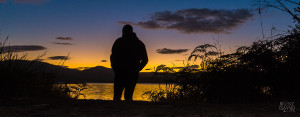 A man at one with nature as he ponders the sunrise