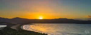 Beautiful landscape panorama of Cloudy Bay at sunrise
