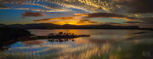 Beautiful scenic panorama of Cloudy Bay Lagoon at sunrise