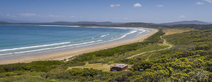 Cloudy Bay Cabin holiday accommodation is an off grid log cabin right on the beach