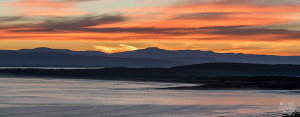 Beautiful sunset view at Cloudy Bay towards south-west Tasmania