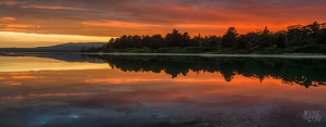 Magnificent sunset view of Cloudy Bay Lagoon with the lagoon mirroring the sky