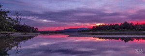 Magnificent purple sunset view of Cloudy Bay Lagoon