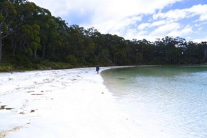 A relaxing walk on Jetty beach on South Bruny with white sands and clear water.