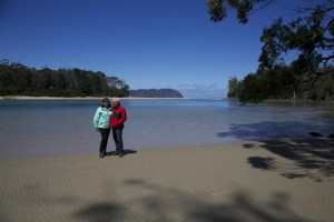 Couple together at the Cloudy Bay Lagoon Inlet on South Bruny, Tasmania