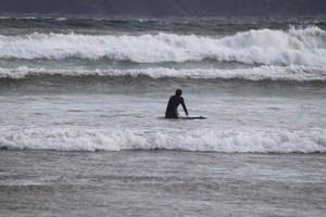 A surfer enjoying the waves at Cloudy Bay.