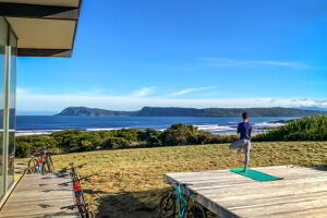 Cloudy Bay Beach House is a great spot for some peaceful outdoor yoga.